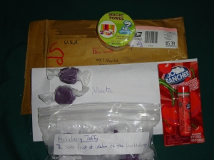 I got a package today from Catlin! (Snoopy magic towel, cherry lip balm, Huckleberry taffy and her letter)